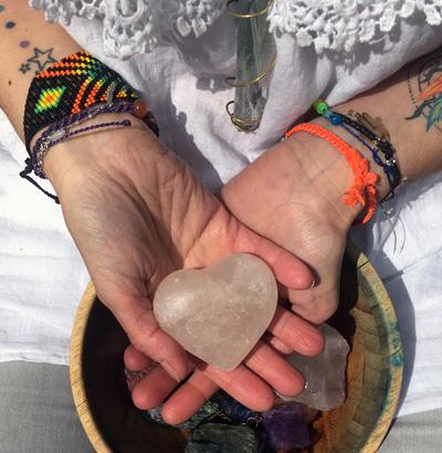 Gloria Urech holding a heart-shaped stone