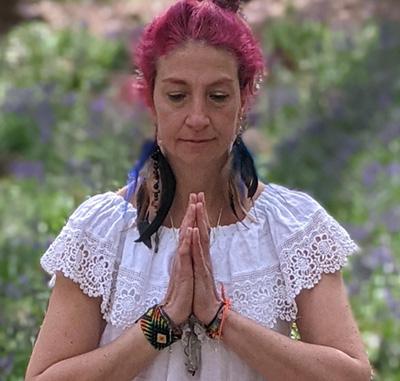 Gloria Urech in prayer hands